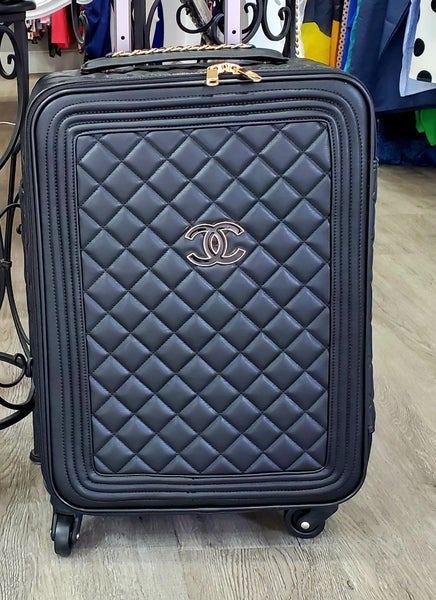 Rolling chanel luggage