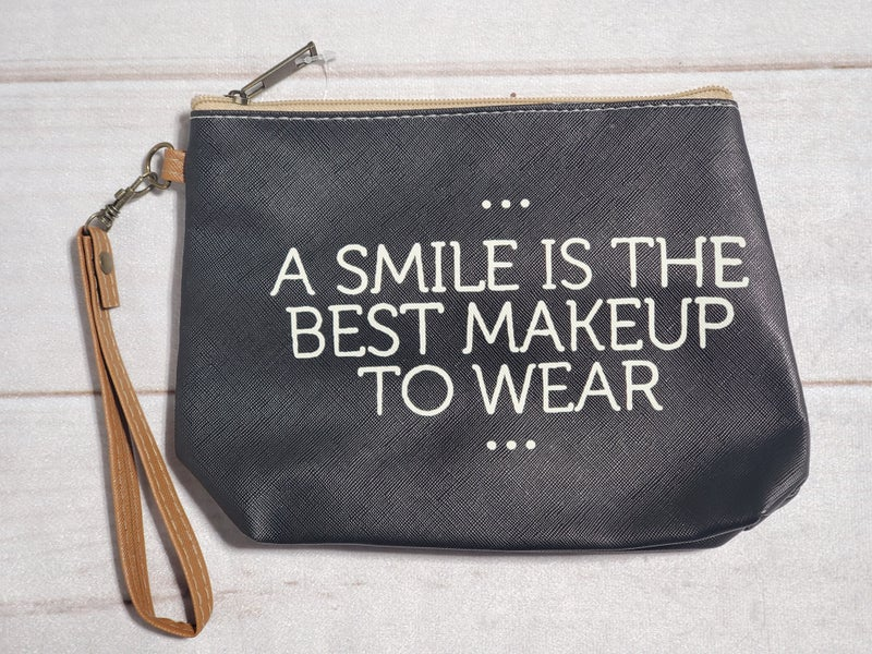A Smile is the Best Makeup to Wear Bag