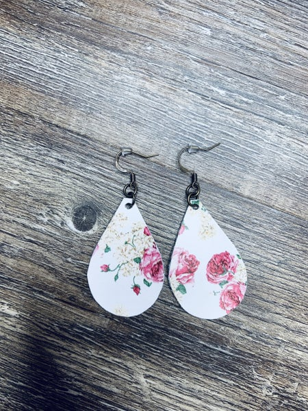 White and floral earrings
