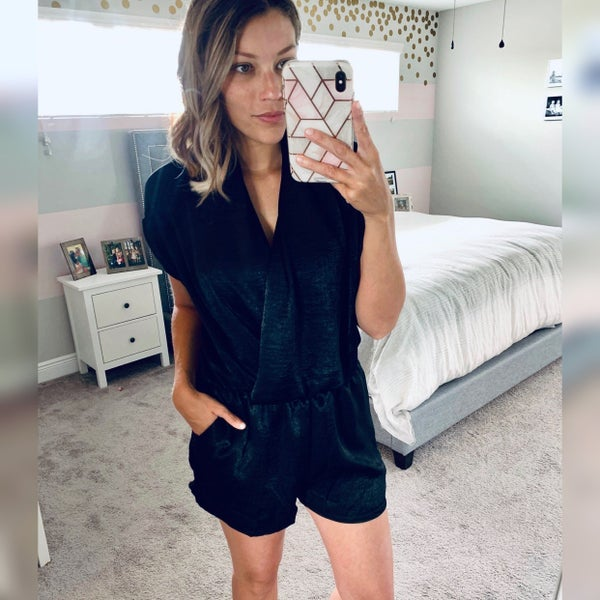 BLACK SHORT SLEEVE WOVEN ROMPER WITH WRAP FRONT DETAIL