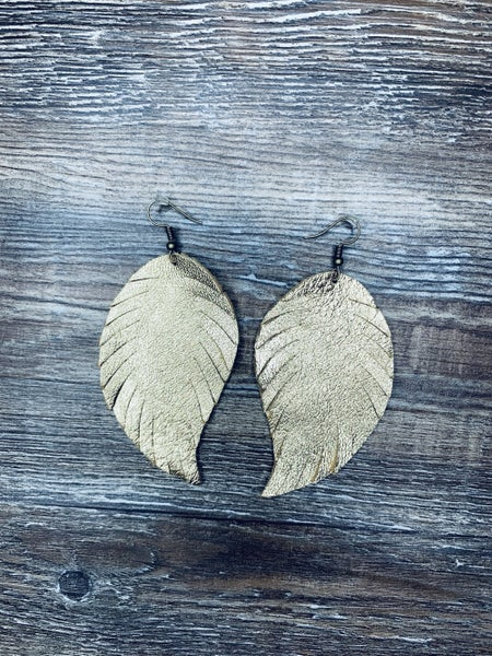 Large gold feather earrings