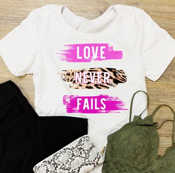 LOVE NEVER FAILS GRAPHIC TEE
