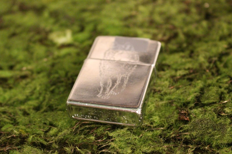 Vintage Chrome Zippo Lighter with Wolf