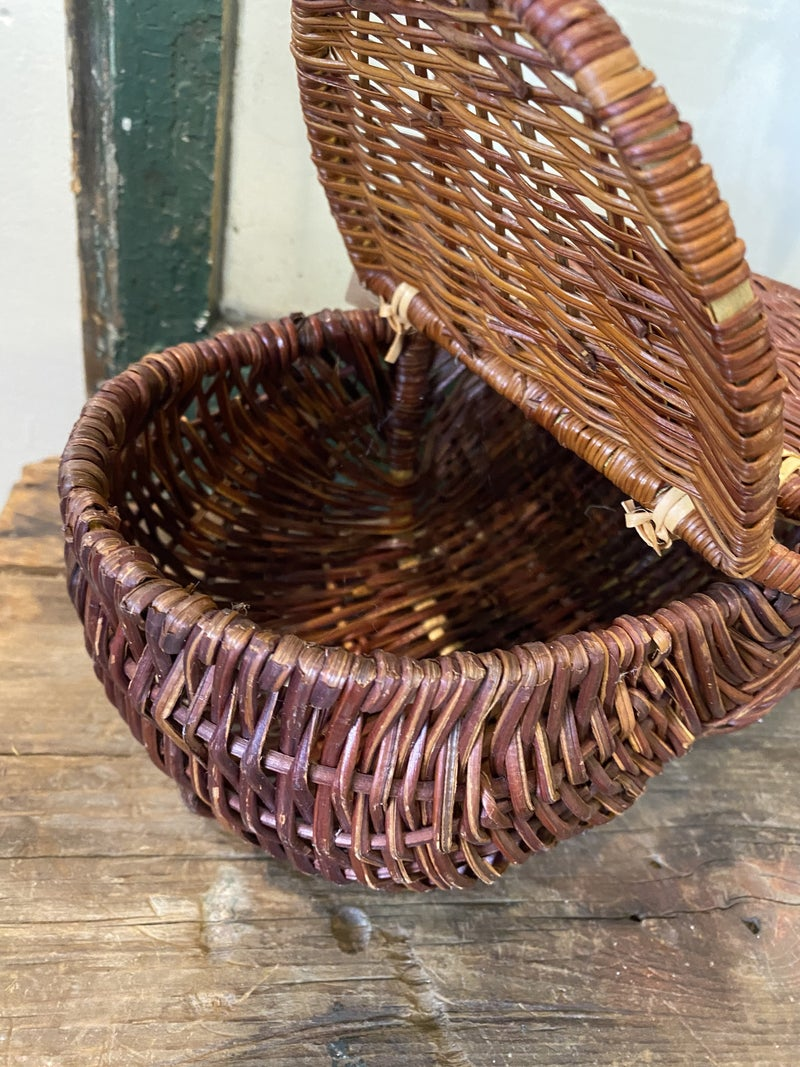 Basket with long handle and lid