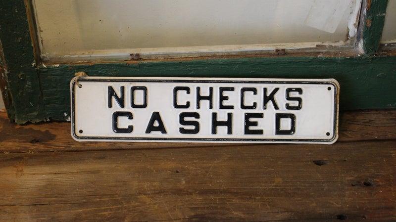 No Checks Cashed Metal Sign