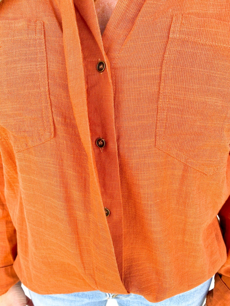 The Rory Rust Button Top With Fray Hem