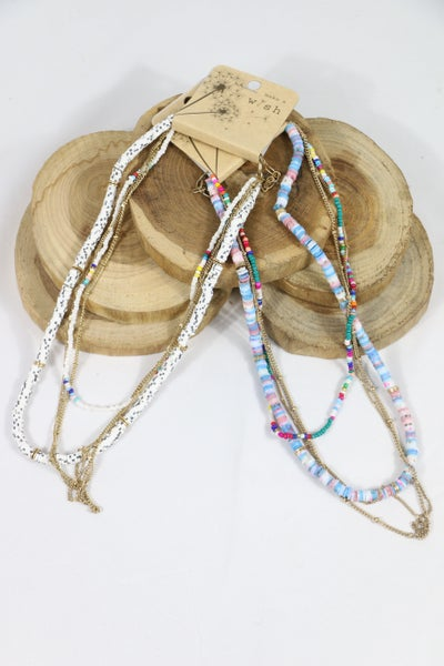 A Little Surprise  4 Strand Bead Metal And Rubber Disc Necklace In Multiple Colors