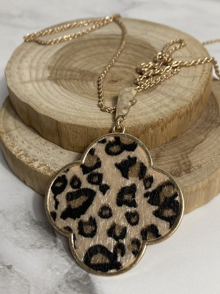 Driven Long Gold Necklace With Large Leopard Clover Pendant
