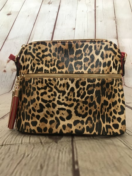 Take the Night Off Leopard Purse with Red Accent Strap and Tasseled Zippers