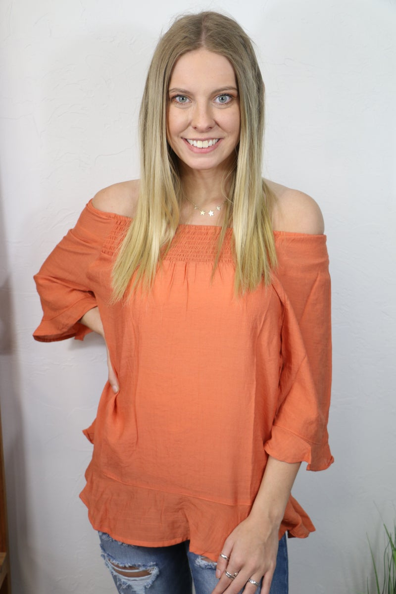 Finding the Light Terracotta Off the Shoulder Three Quarter Sleeve Top with Ruffled Hem - Sizes 4-10