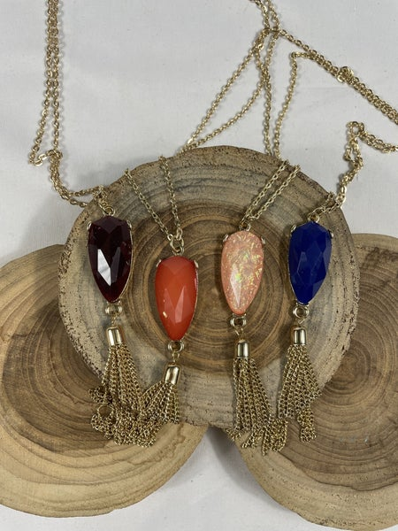 As You Wish Long Gold Necklace With Shield Pendant And Gold Tassel In Multiple Colors