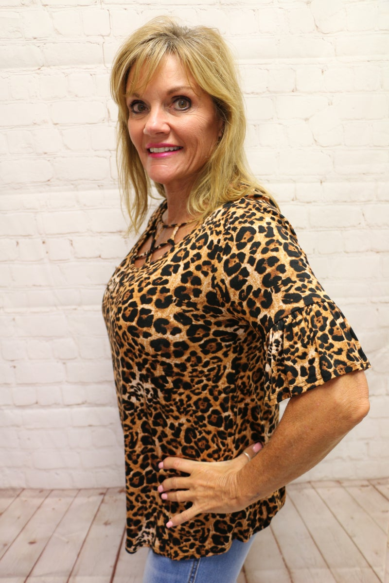 Bright Eyed Leopard Top with Criss Cross Neckline and Ruffle Sleeve- Sizes 4-10