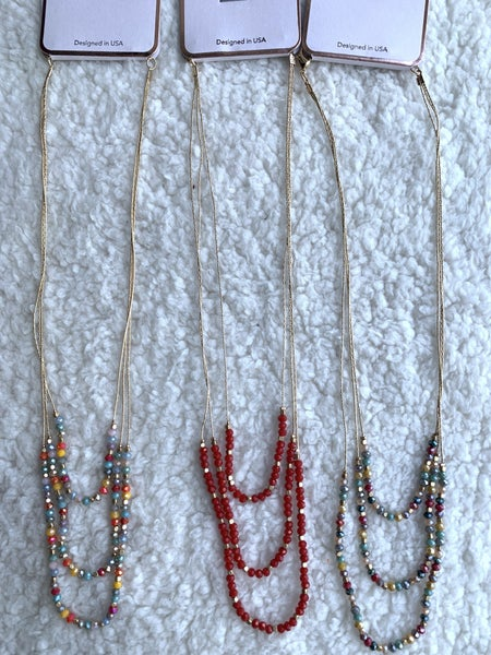 It's A Charmer 3 Strand Beaded Gold Necklace In Multiple Colors