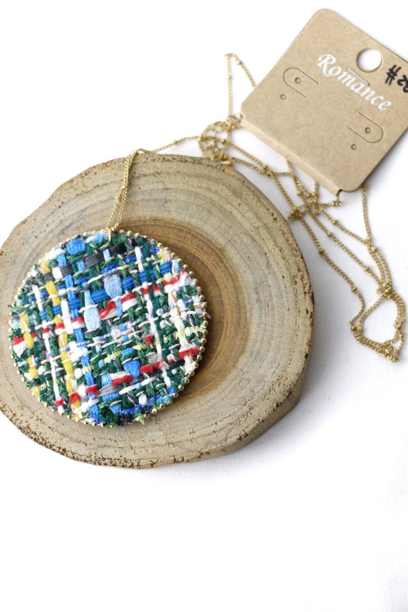 Around The World Round Woven Yarn Necklace In Blue