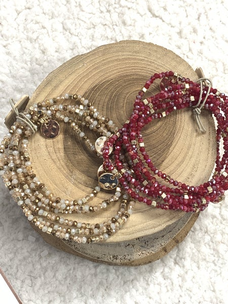 Feeling Cute 6 Strand Burgundy Beaded Bracelet With Gold Hammered Disc Pendants