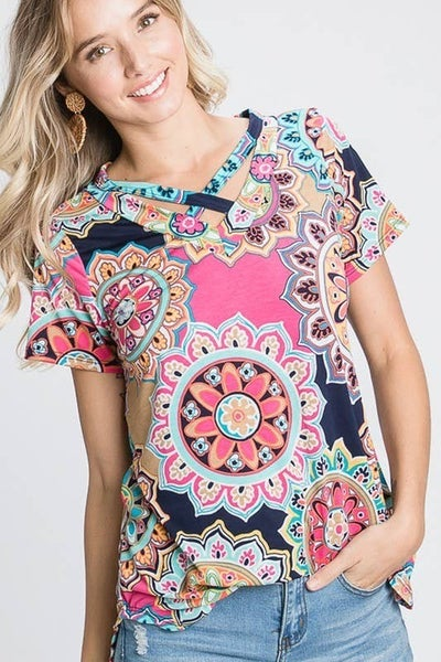 See the Bright Side Paisley Criss Cross Neckline Short Sleeve Top in Multiple Colors - Sizes 4-20