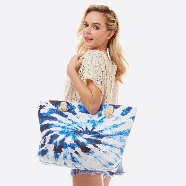 Blue Tie-Dye Tote Bag Featuring Rope Handles.