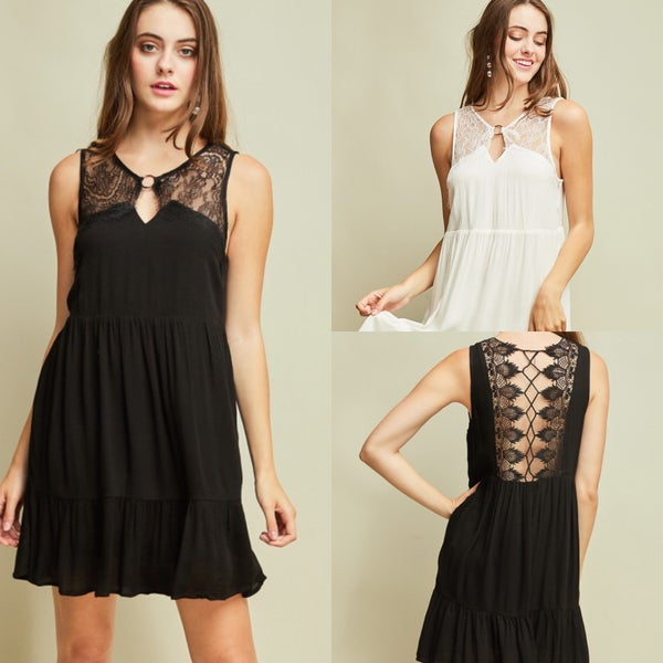 Solid sleeveless babydoll dress featuring front and back cutout with brass ring and contrast lace detail