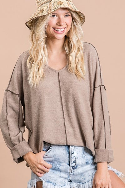 Brushed knit top with edge stitch details