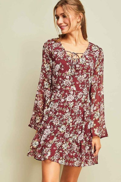 Floral long-sleeve babydoll dress featuring double self-tie detail at neckline