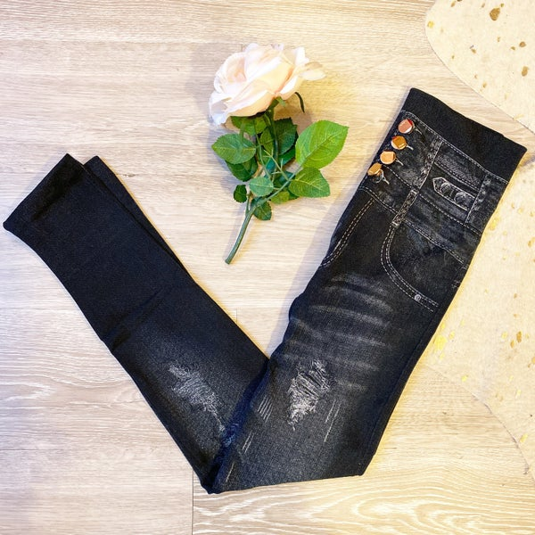 Black jeggings with faux buttons