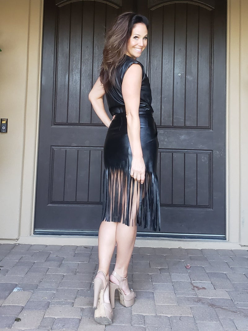Black Faux Leather Sleeveless Shoulder Pad Top &  Cross Over Fringed Skirt
