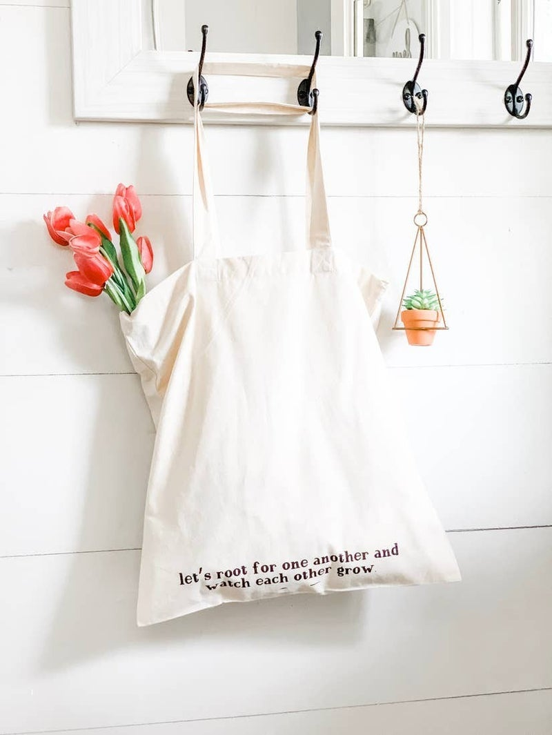 'Let's root for one another' tote bag