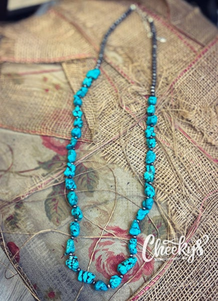 Cheeky's Rocking That Turquoise Stone and Navajo Bead Necklace