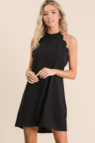 Scalloped short dress with back ribbon tie with lining.