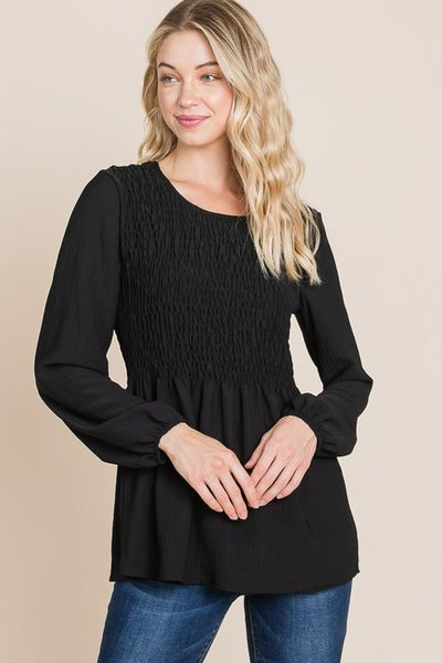 A long sleeve woven blouse with smocking and puff sleeve detail