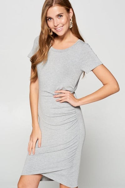 Short sleeve knit dress featuring side ruching details and front tulip hems