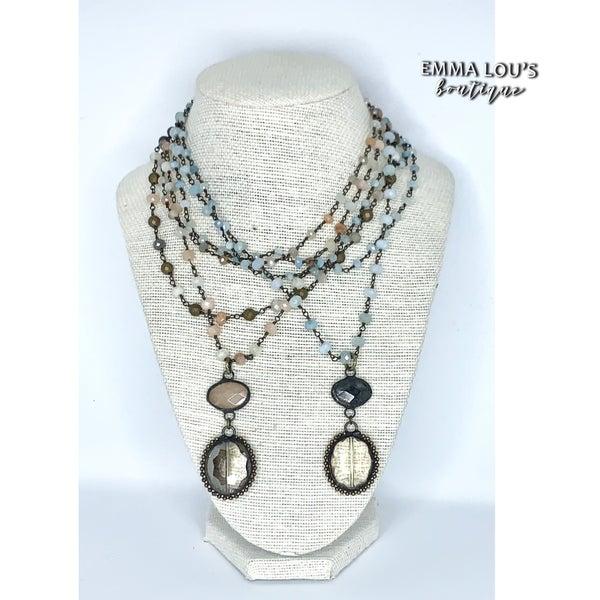 Melania Clara Multi Strand Beaded Necklace with Round Pendant
