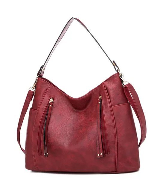 The Mary Cross Body with tassled front zippers