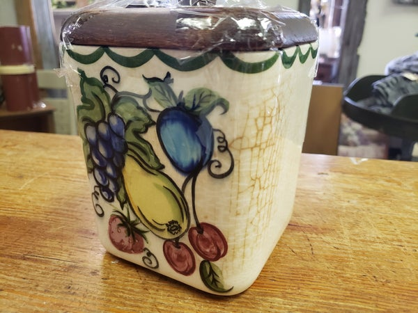 Vintage ceramic fruit jar with wood lid