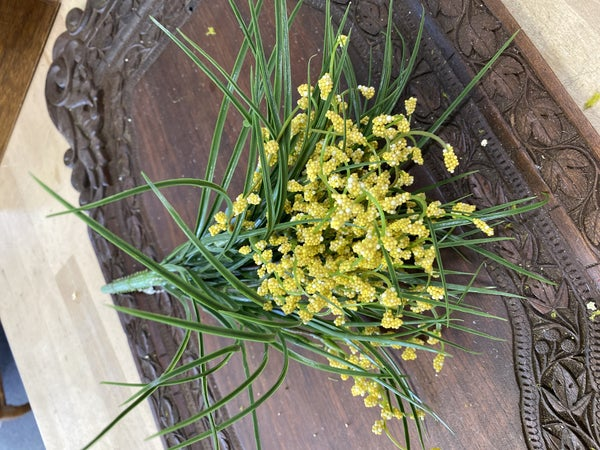 Wild grass and blooms pick yellow