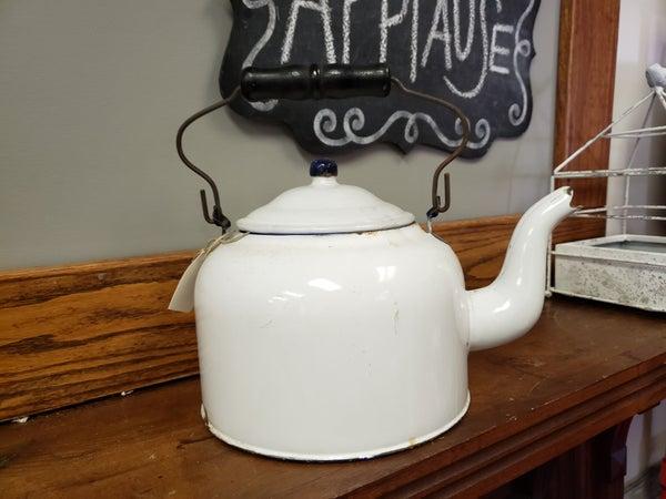 White enamelware teapot