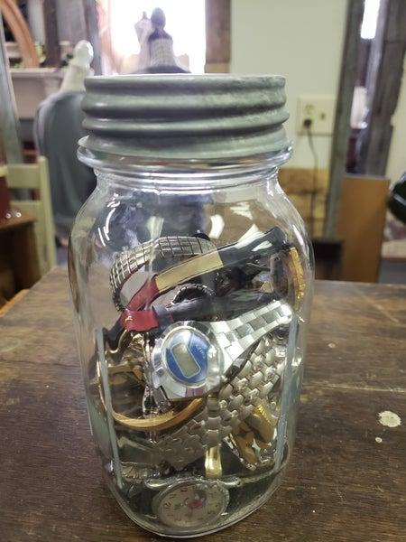 Vintage ball jar of jewelry