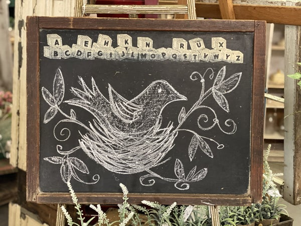 Vintage chalkboard with bird on nest