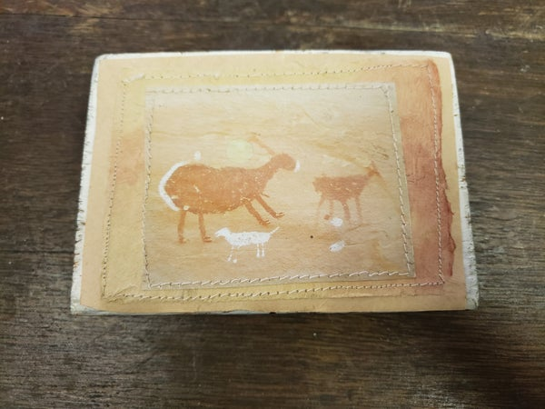 Wood block with goats