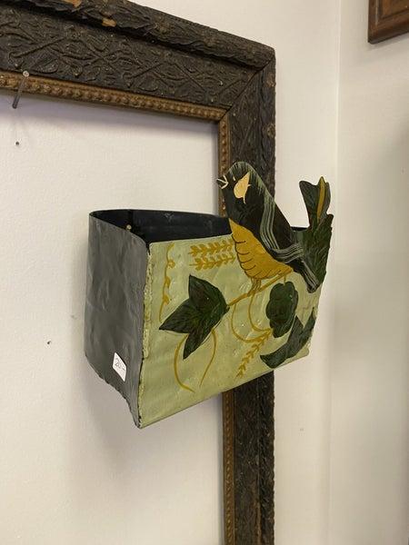 Metal bird wall pocket
