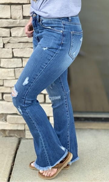 Risen High Rise Distressed Raw Hem Flare Denim Jean