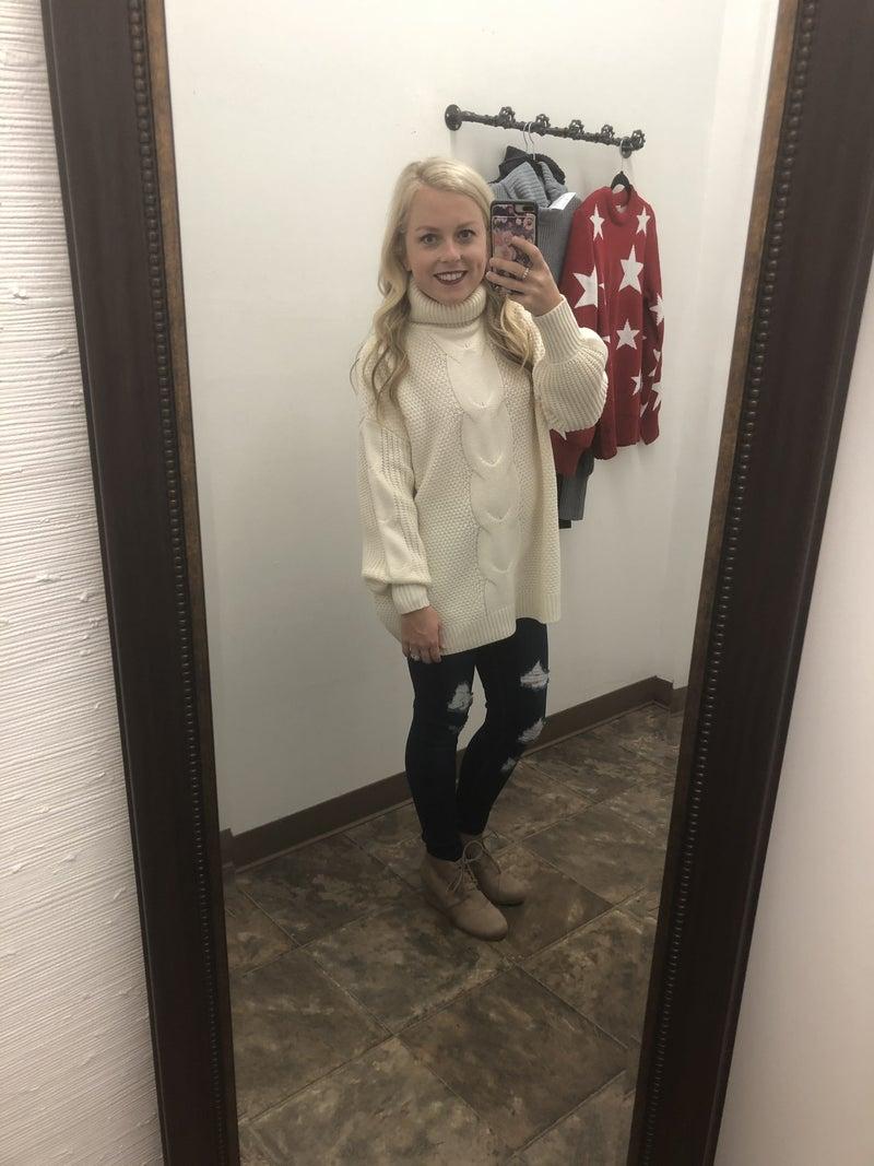 Braided turtleneck sweater
