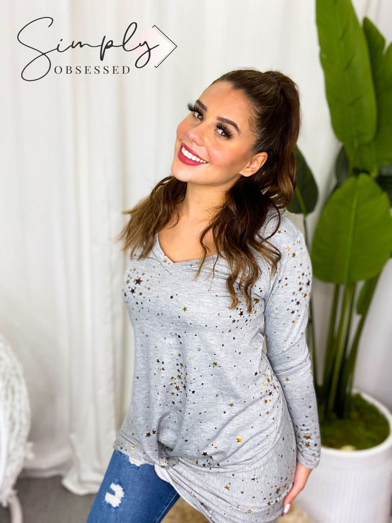 Fantastic Fawn - Long sleeve knit twist front dress with foil stars