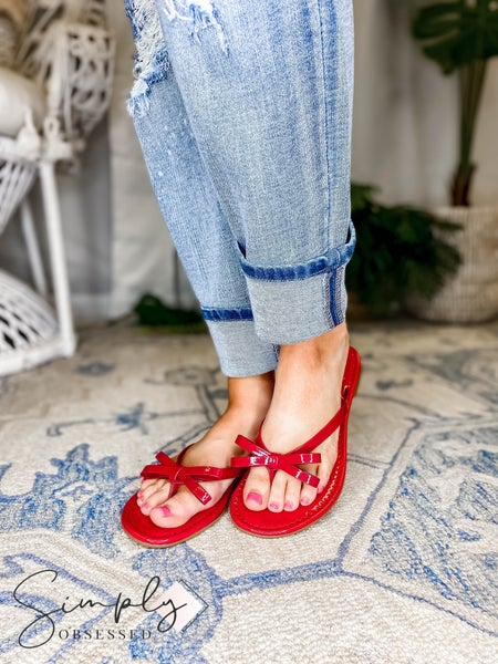 Maker -  Patent Leather Flip Flop with Bow Detail