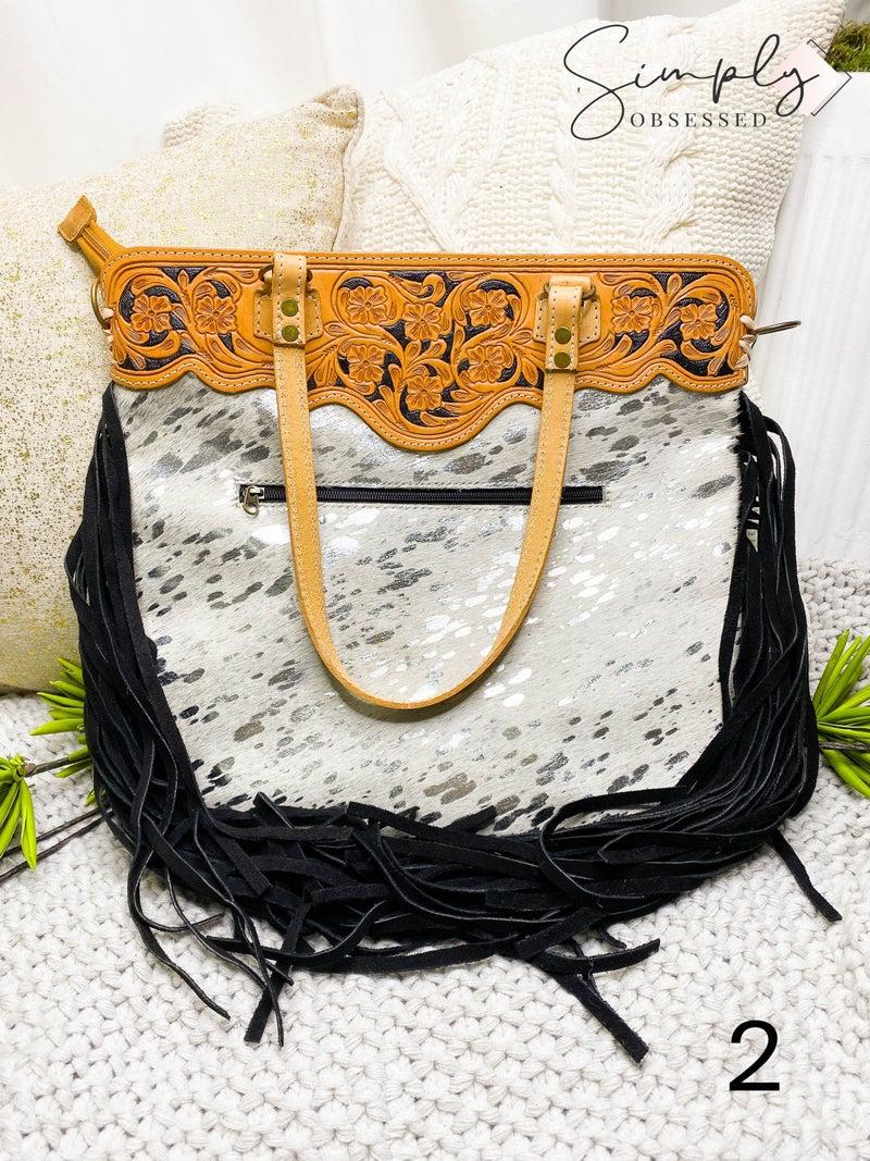 Hand crafted leather work tassel detail acid wash cross body handbag