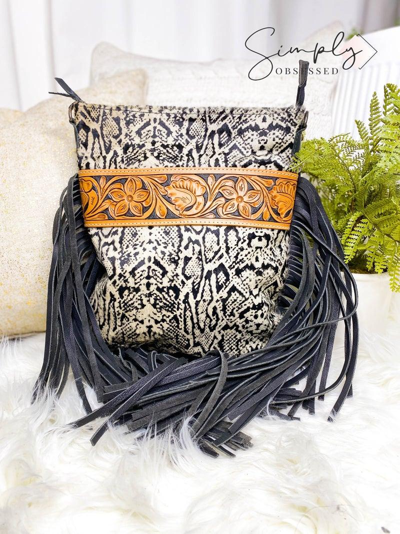 Leather work tassel detail cross body handbag