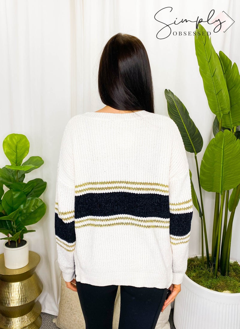 Kye Mi - Knitted sweater with subtle metallic golden sparkle