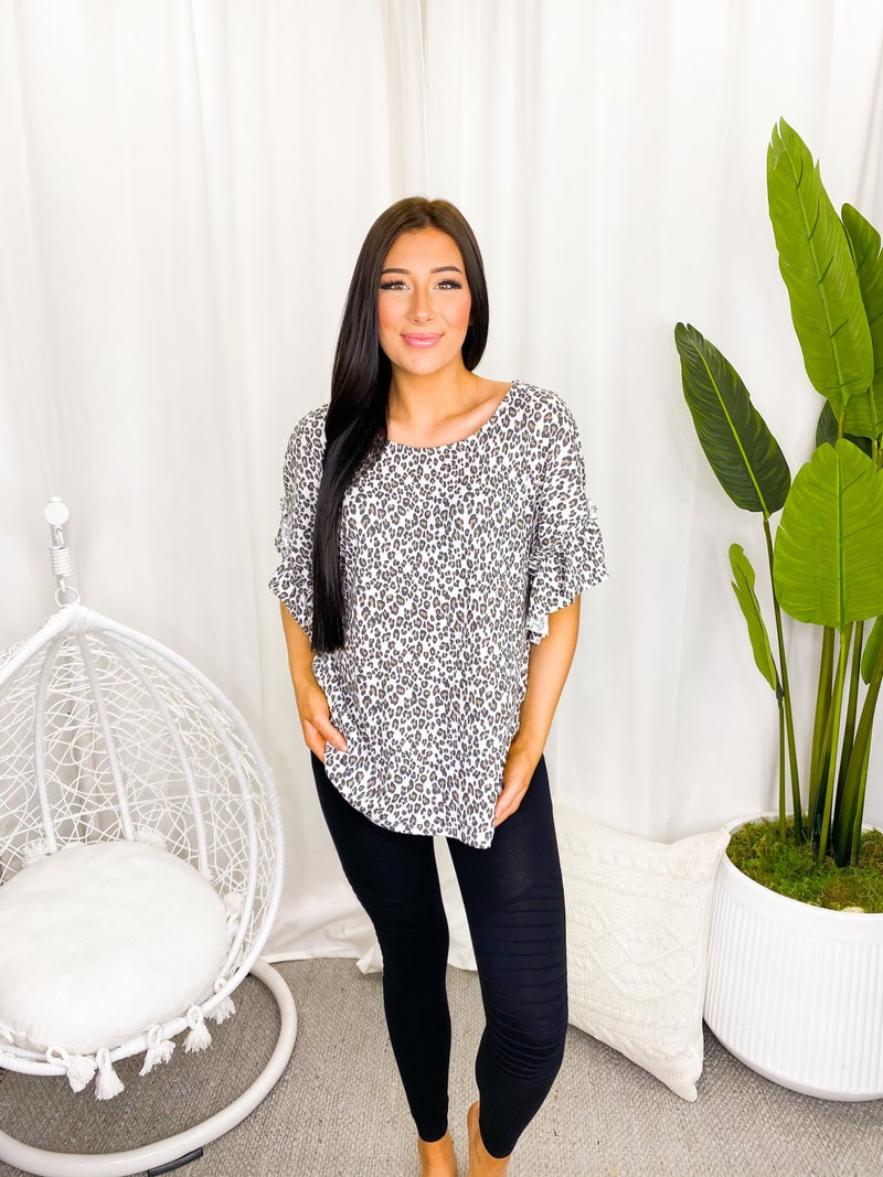 Blue Buttercup - Leopard all over top with ruffled sleeve