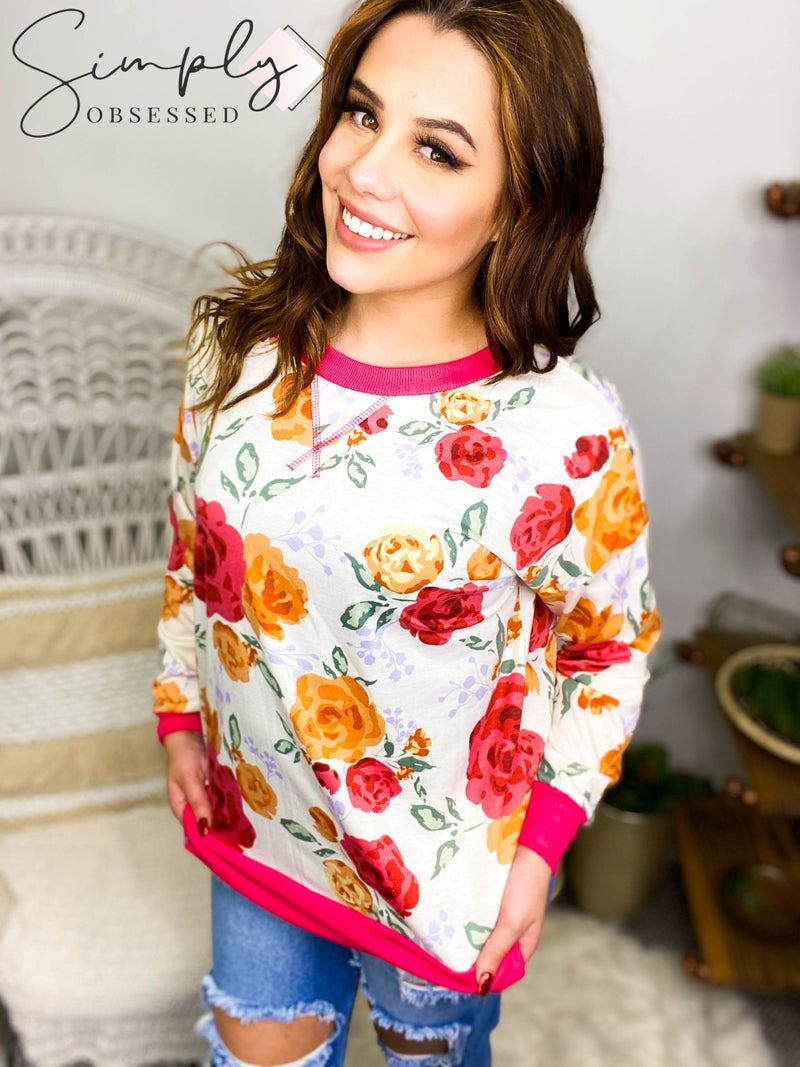 HONEY ME-ROUND NE3CK LONG SLEEVE TOP WITH FLORAL DETAIL