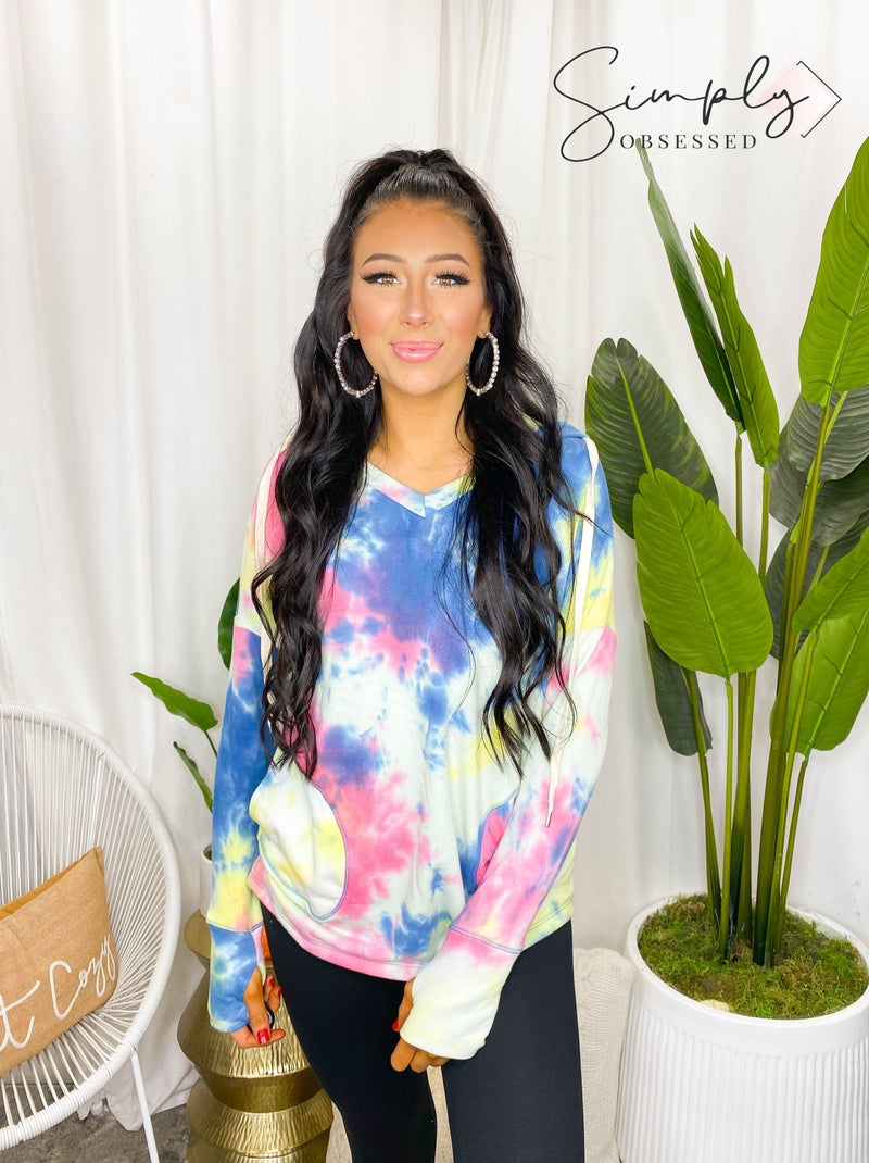 White Birch - Long sleeve tie dye knit sweater with a v-neck featuring a reverse stitching, hoodie, and side pockets